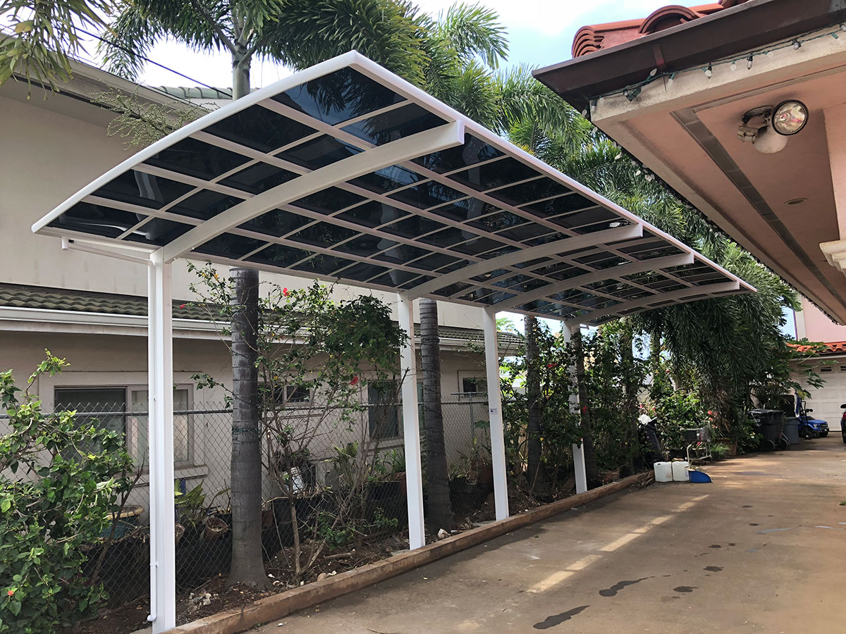 White tandem carport structure with the dark grey color