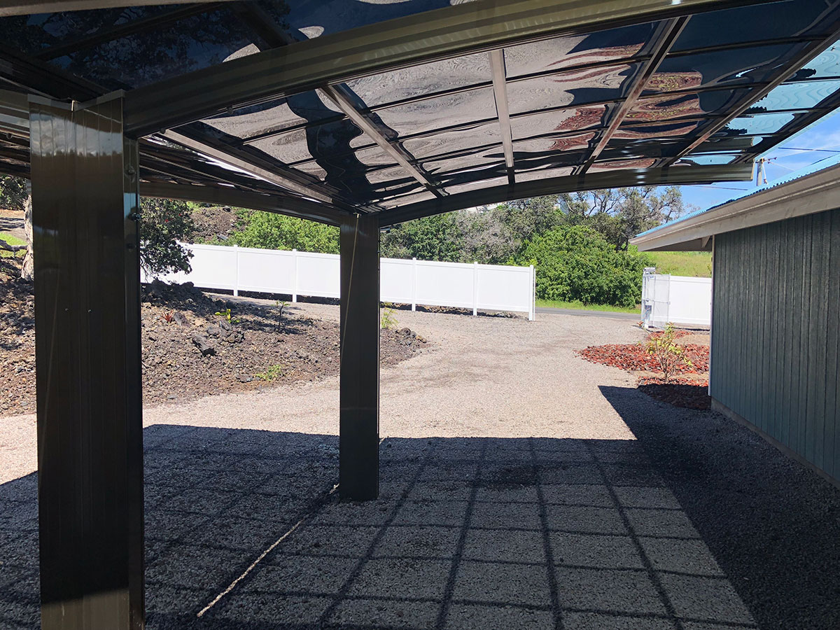 Two champagne carports with dark gray panels in the Y confoguration
