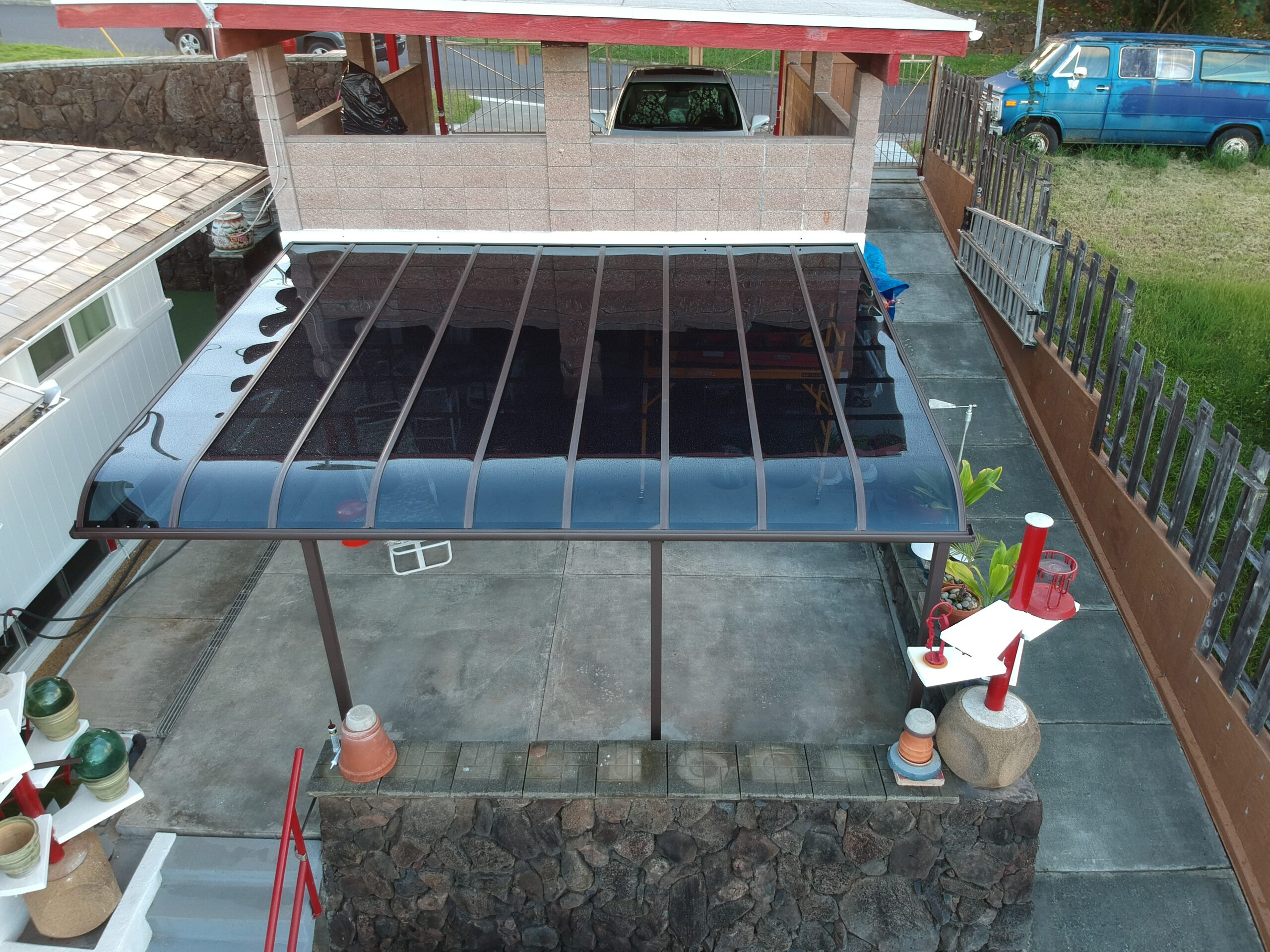 Patio Cover in dark polycarbonate panel and a brown frame, carports hawaii.com