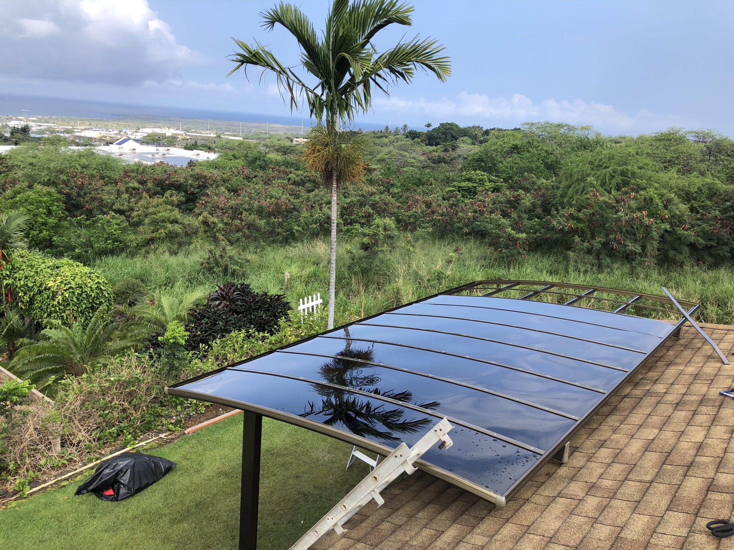 Singla brown carport with dark grey polycarbonate roof panels
