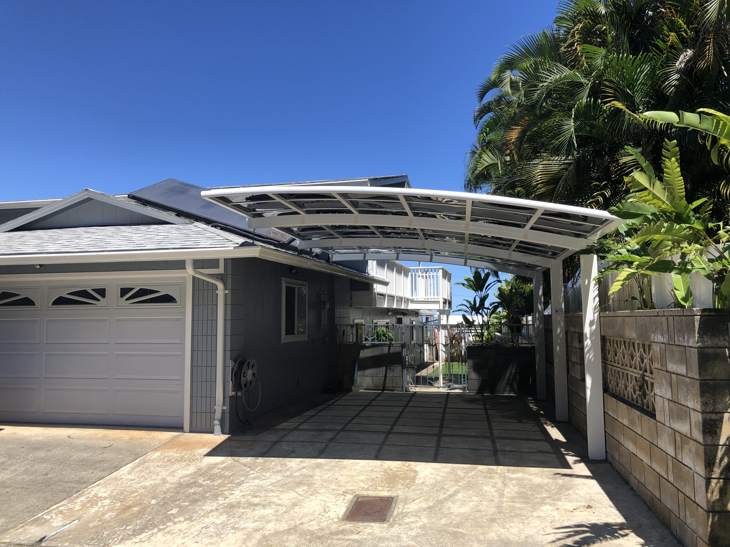 Carports Hawaii, custom carport structure, white aluminum frame with dark polycarbonate roof panels