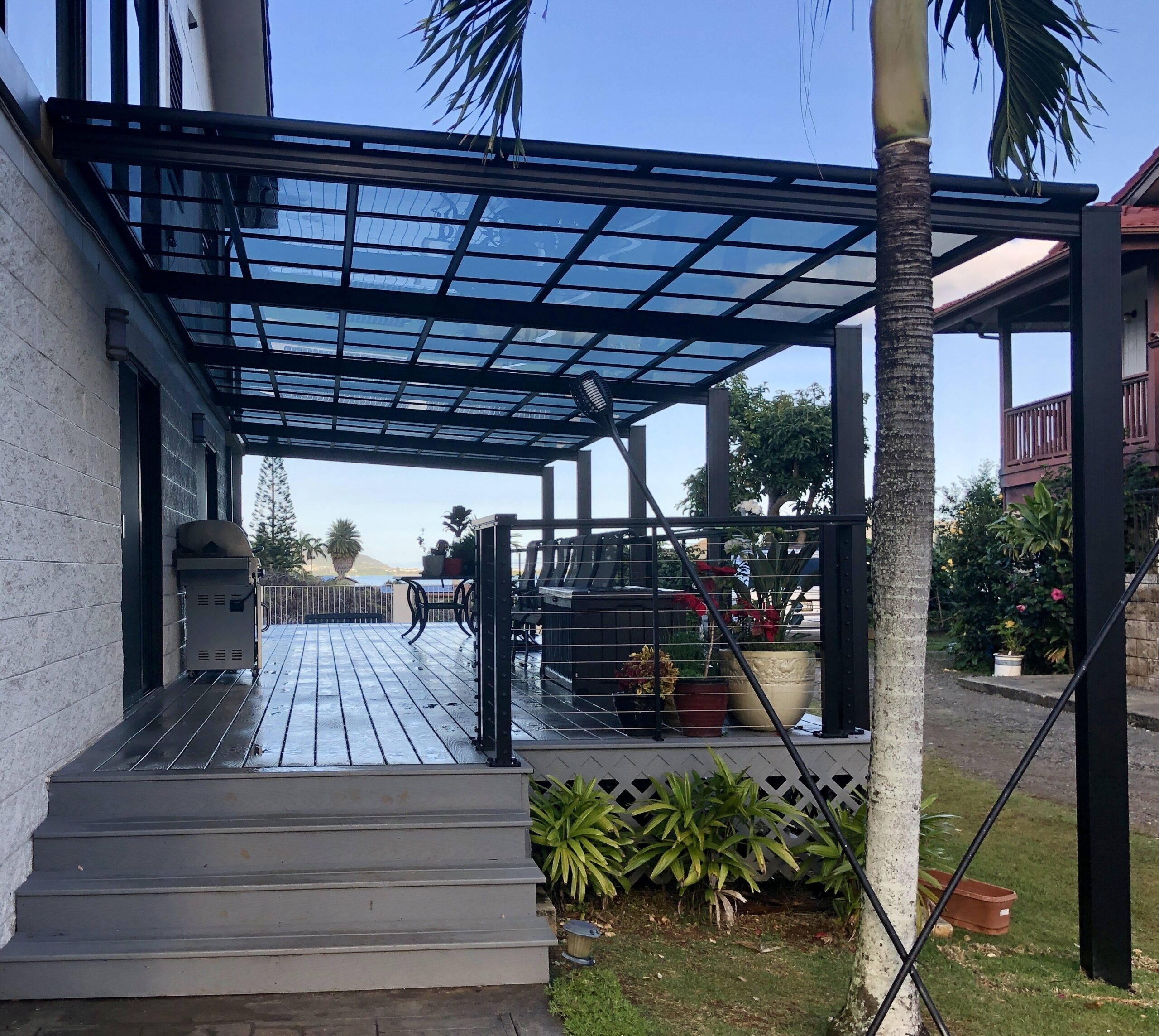 Aluminum Patio Cover, Dark Anodized Aluminum profile with the smoke gray polycarbonate panel.